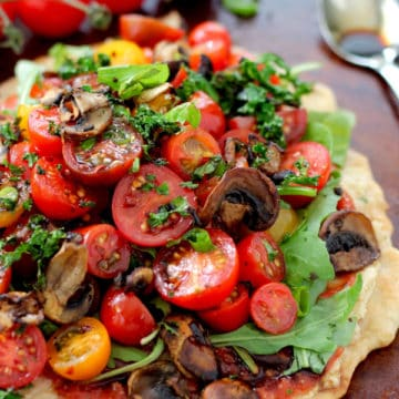 tomatoes and mushrooms piled on pizza