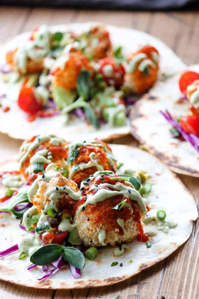 sriracha cauliflower wings with thai sauce on taco shell
