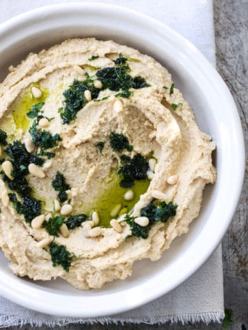 garlicky chickpea hummus served in a bowl