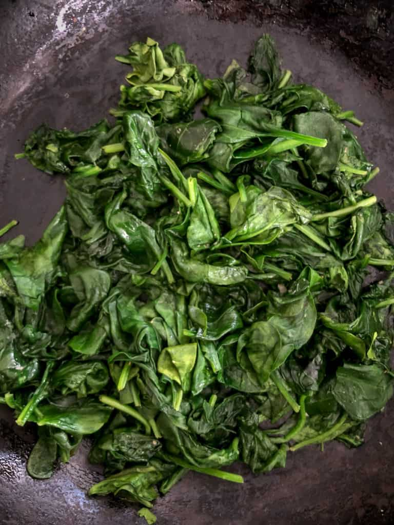 Steamed spinach in a skillet.