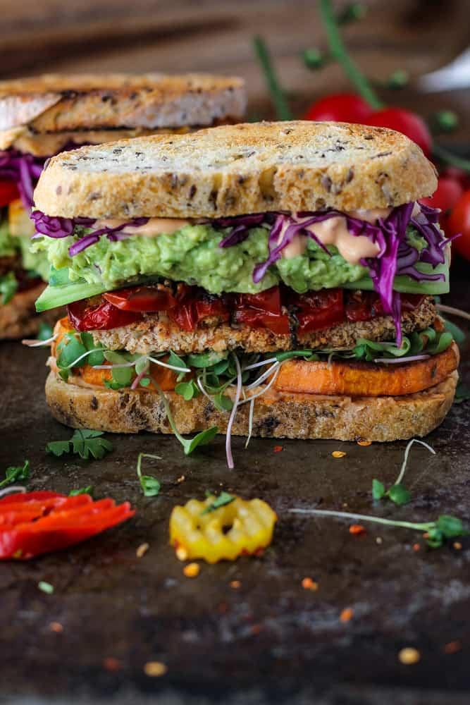 big vegetable, guacamole, and tofu sandwich on 2 slices of sourdough