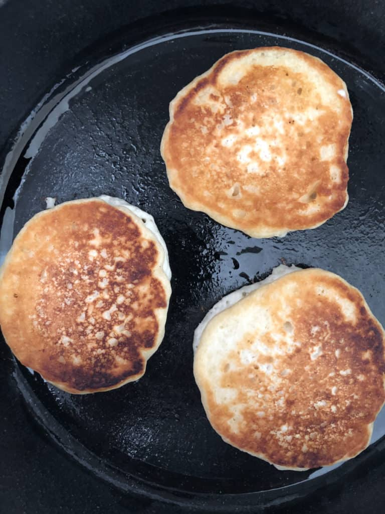 Pancakes being fried in a skillet.