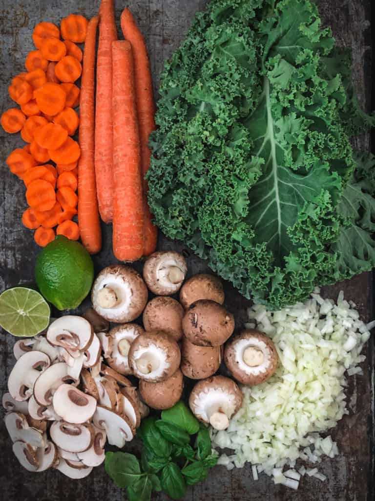 Vegetables for Cauliflower Soup laid out on a baking sheet.