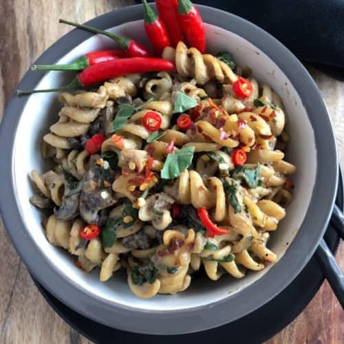 Bowl of vegan mushroom pasta.