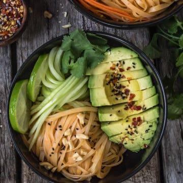 Dan Dan noodle bowl with cucumbers and avocado.