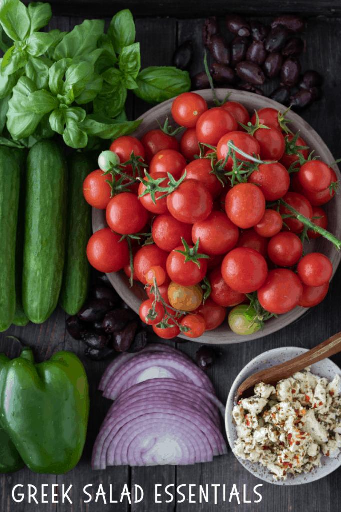 Greek salad ingredients on a tray.