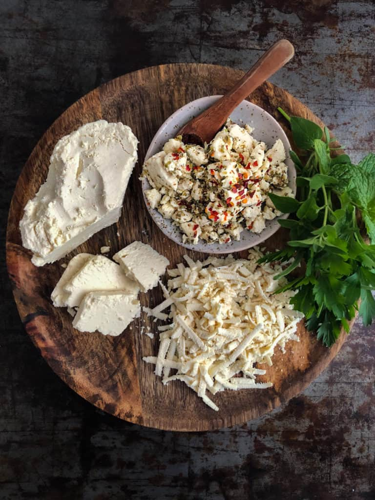 Tray of vegan feta cheese, crumbled, grated and block.