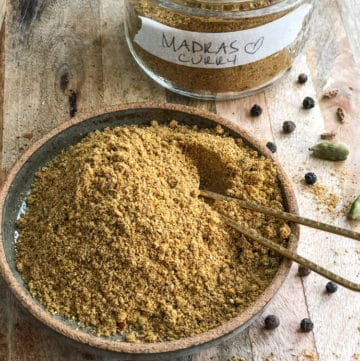 Ground spice for madras curry spice blend in a dish.