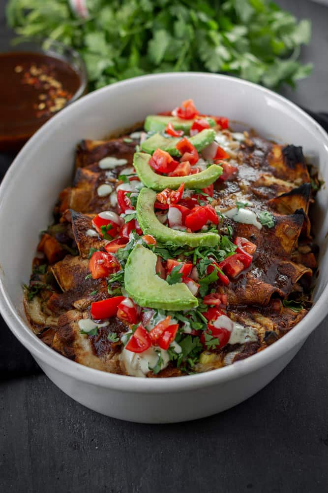 Spicy poblano mushroom enchiladas in a baking dish.