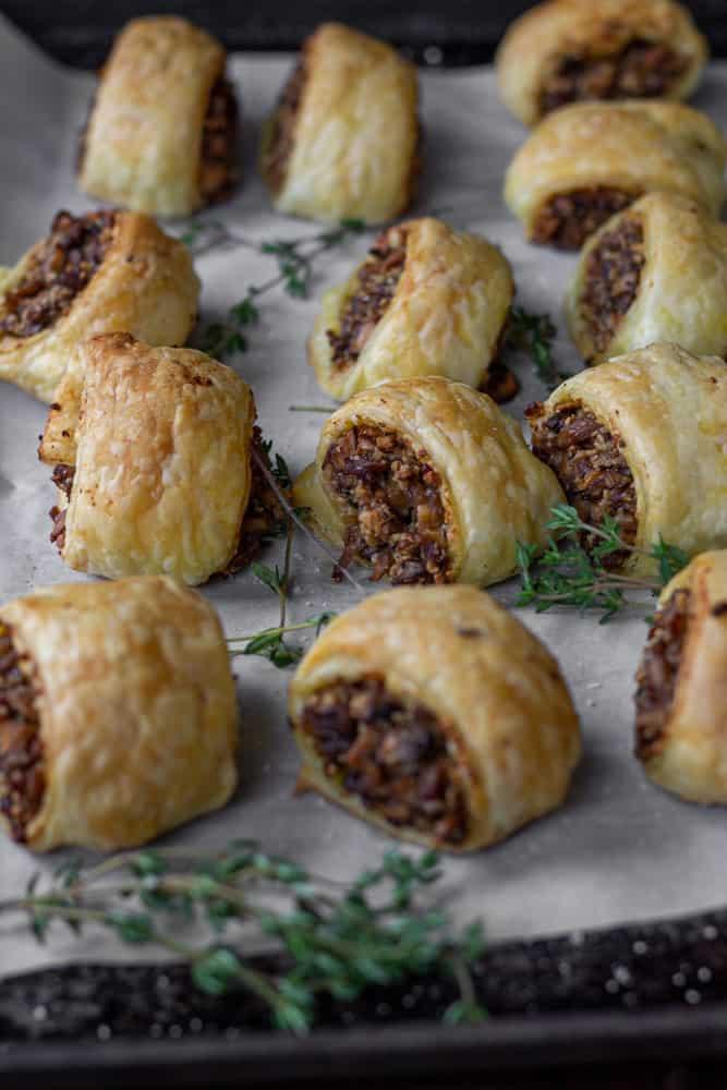 Vegan vegetarian sausage rolls on baking sheet.
