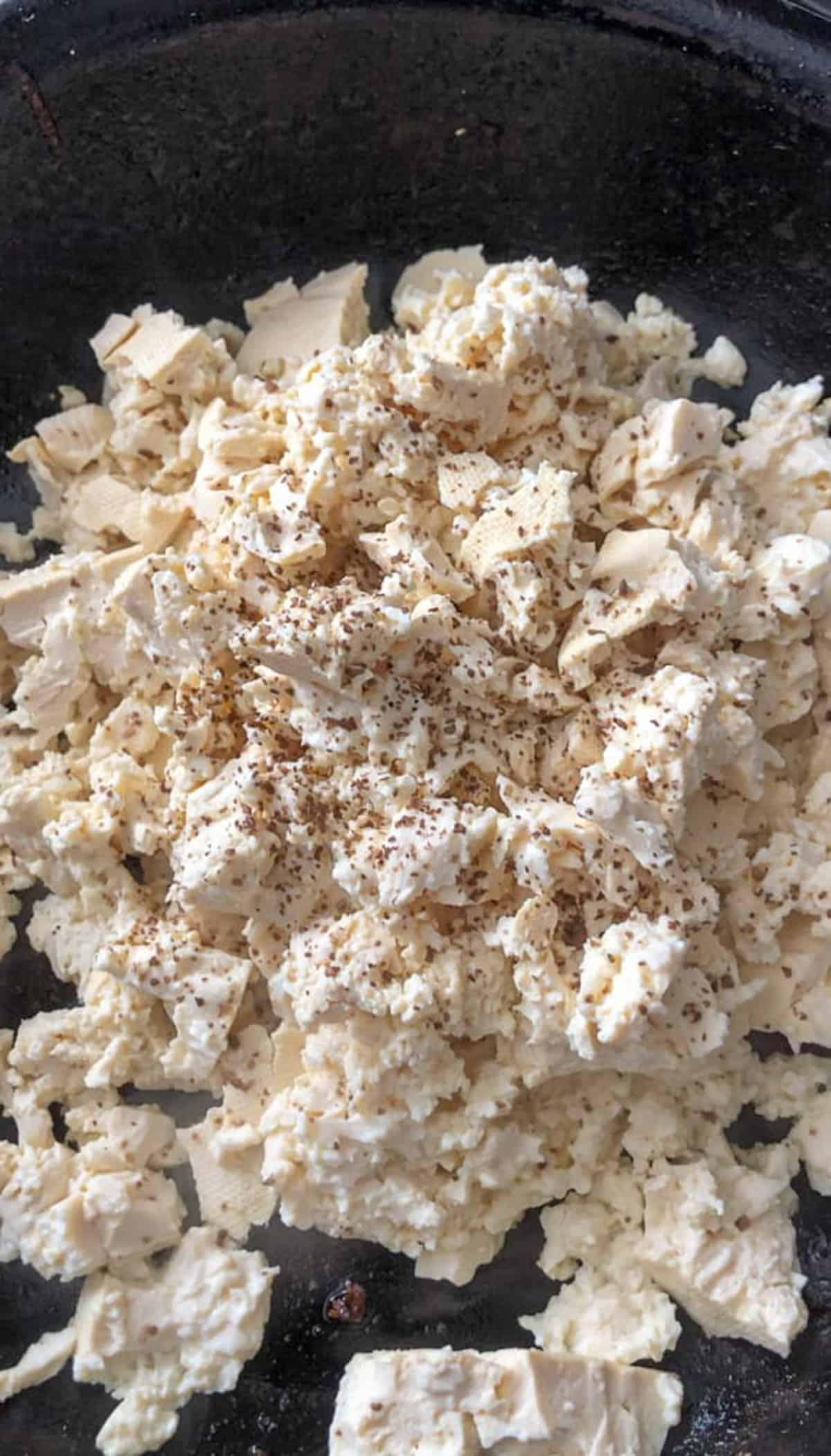 Tofu scramble in a skillet.