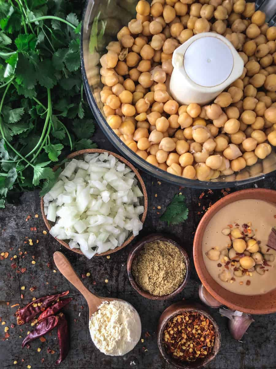Ingredients for baked vegan falafel including chickpeas, onions, tahini and spices.