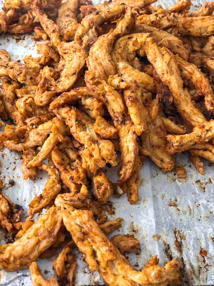 Vegan chicken replacement soy curls on baking sheet.