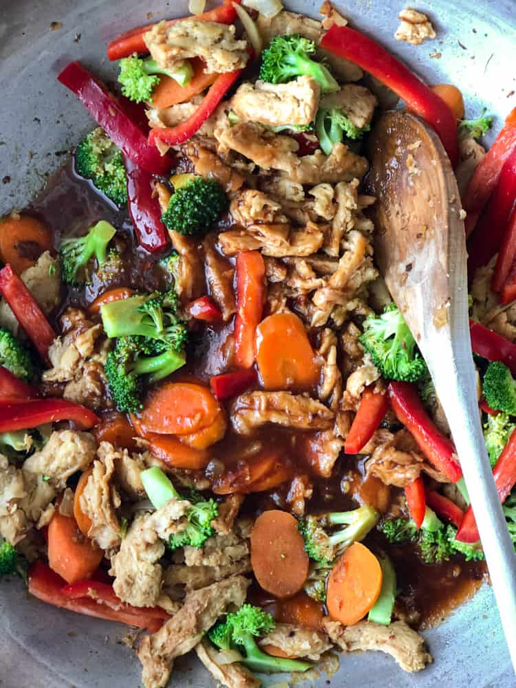 Soy curls and colourful vegetables being stir fried in a sweet spicy cashew sauce.