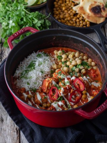 creamy cauliflower curry in a pot with chickpeas and tofu