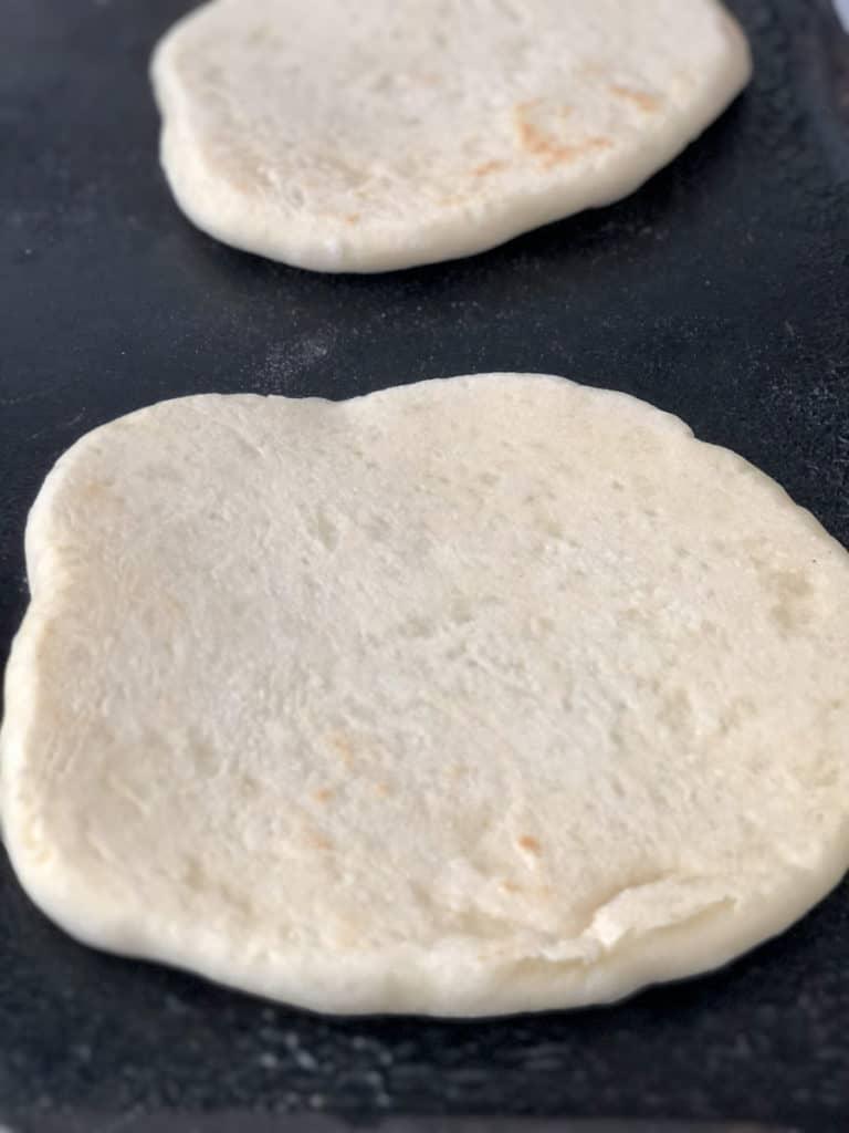 Pita round being fried on