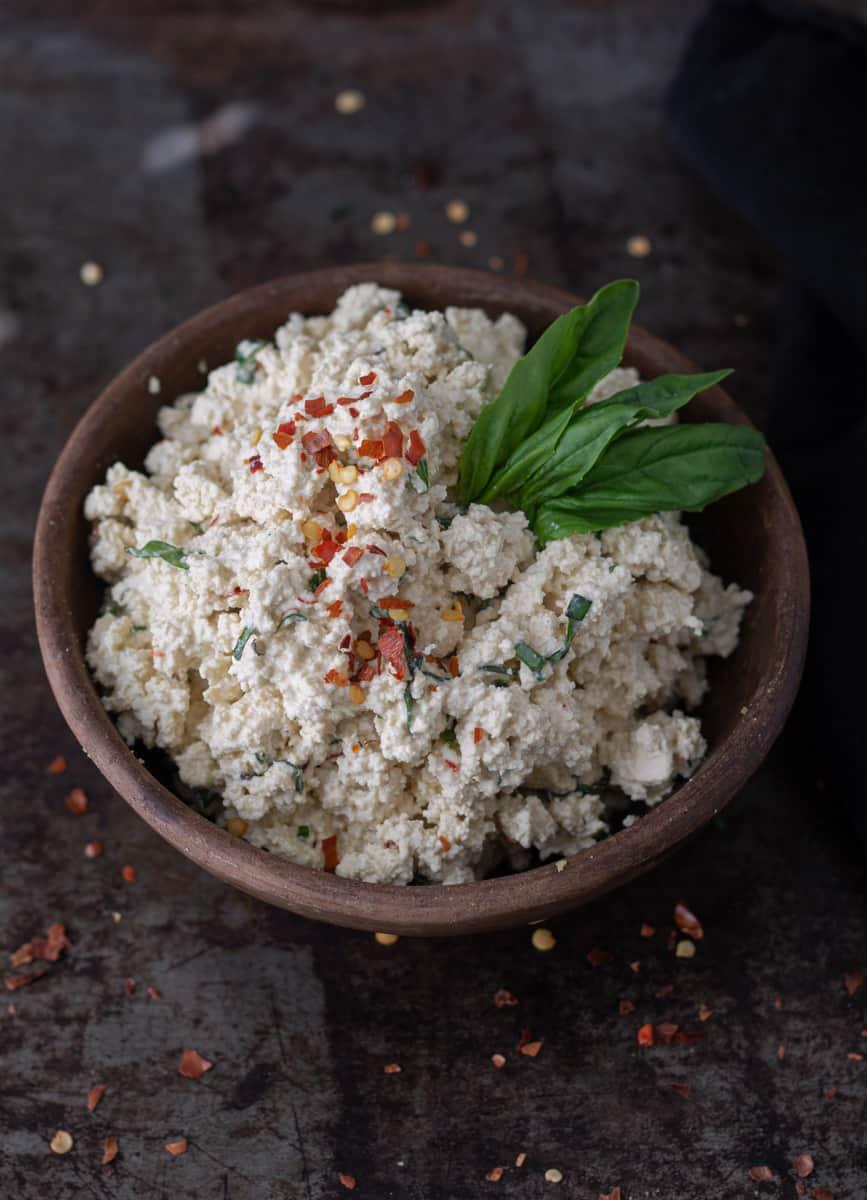 Bowl of vegan tofu-cashew ricotta cheese in a bowl.