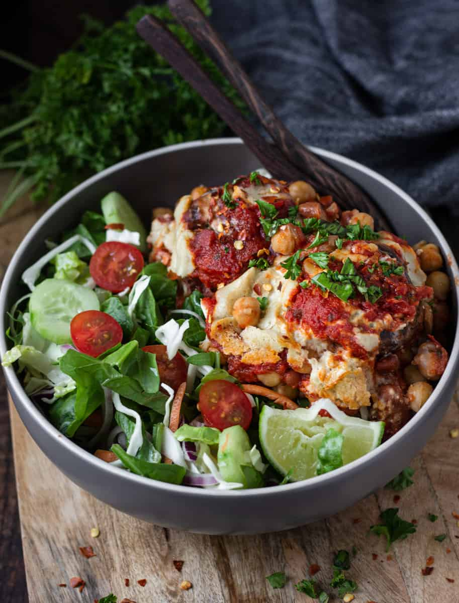 Bowl of chickpea mushroom bake and green side salad.