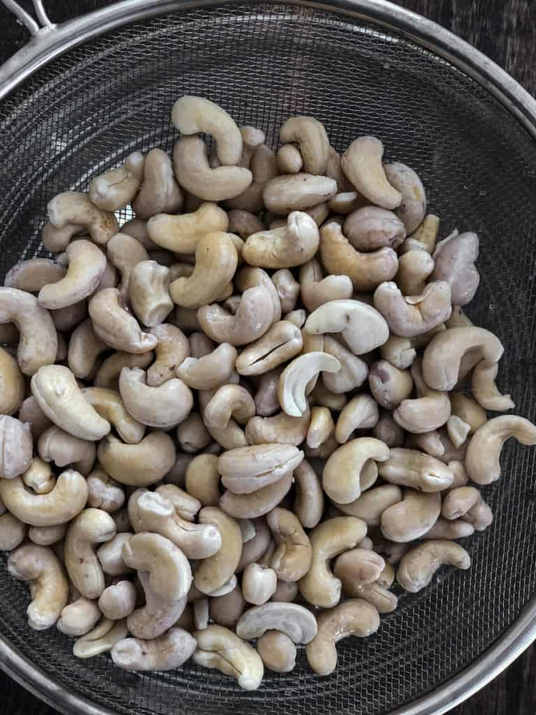 Soaked cashews in a bowl.