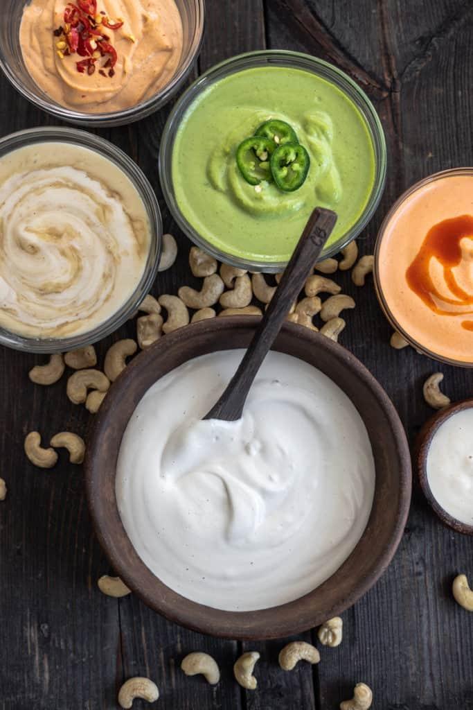 Bowlsful of colourful cashew cream sauce.