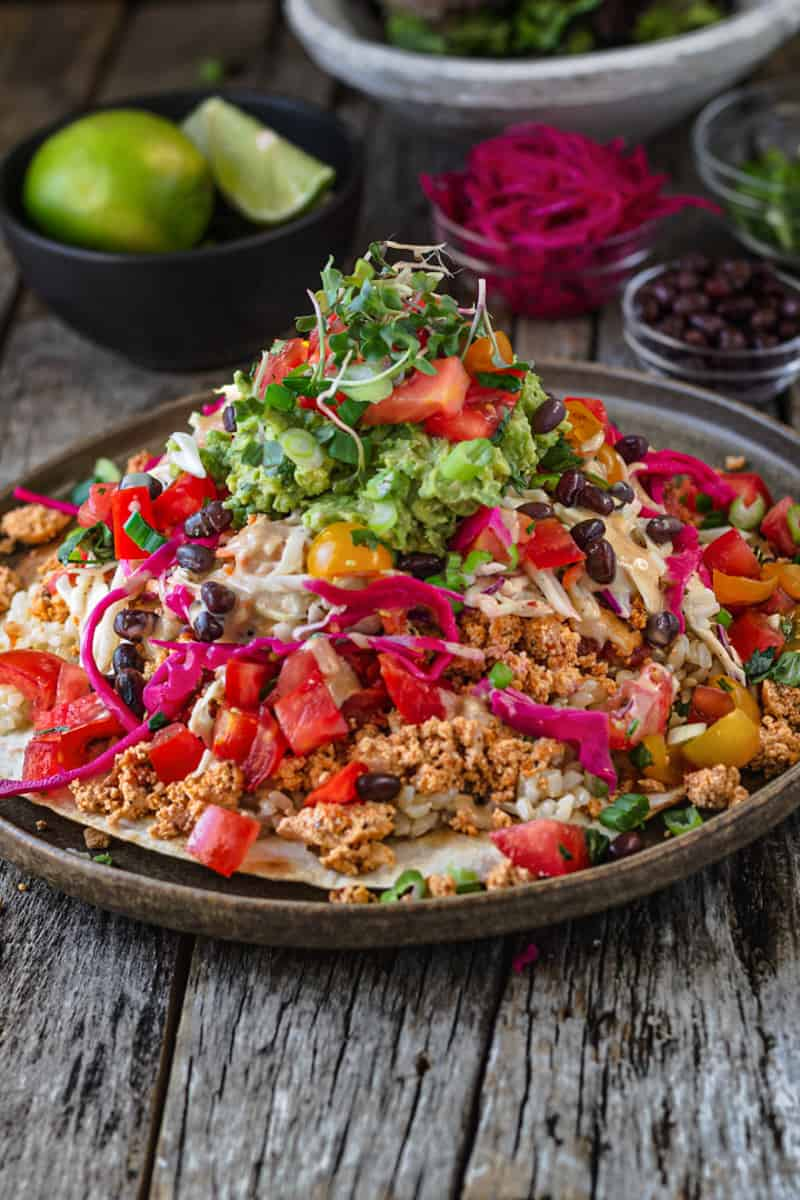 Taco Rice Bowl pile high with slaw, guacamole, and taco filling.