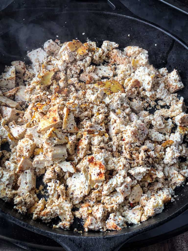 Skillet full of spiced tofu crumbles filling for tacos.