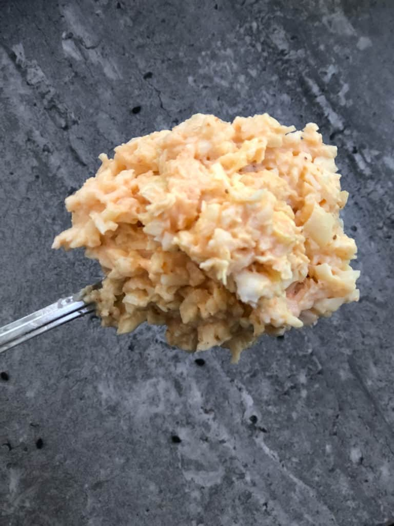 Spoonful of hearts of palm crab for vegan sushi.