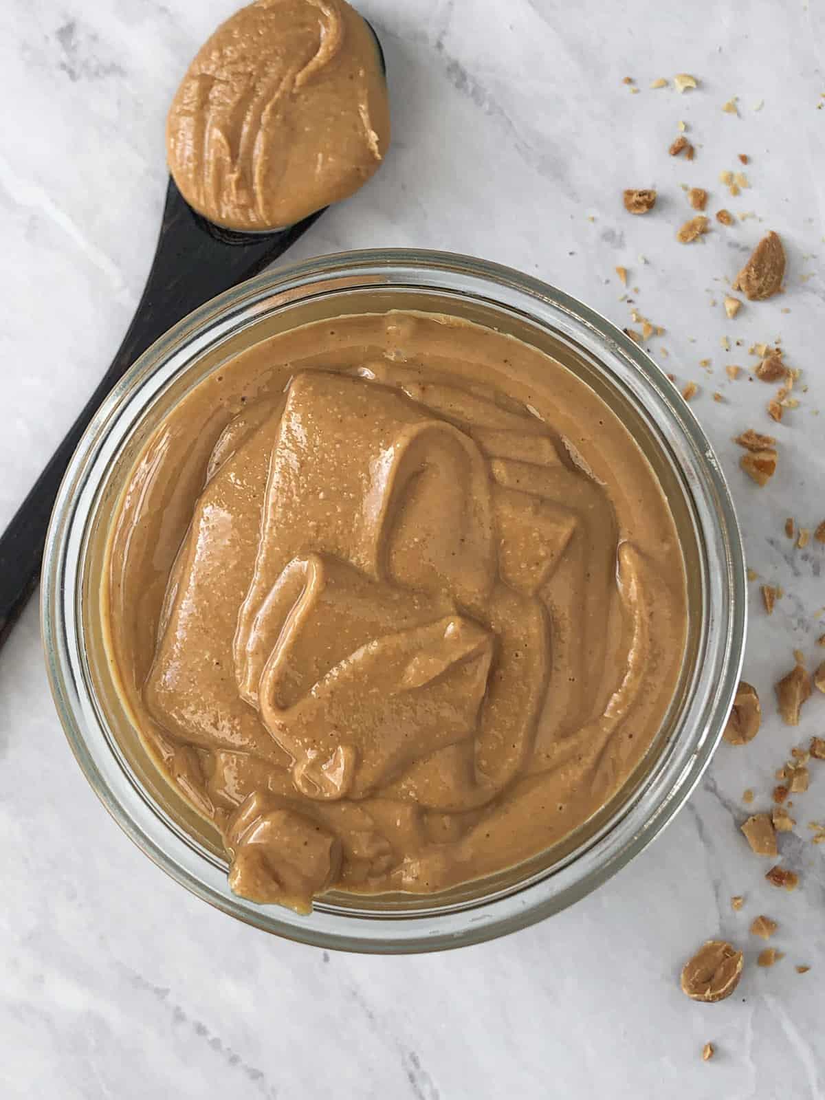 Jar of homemade rich creamy peanut butter.