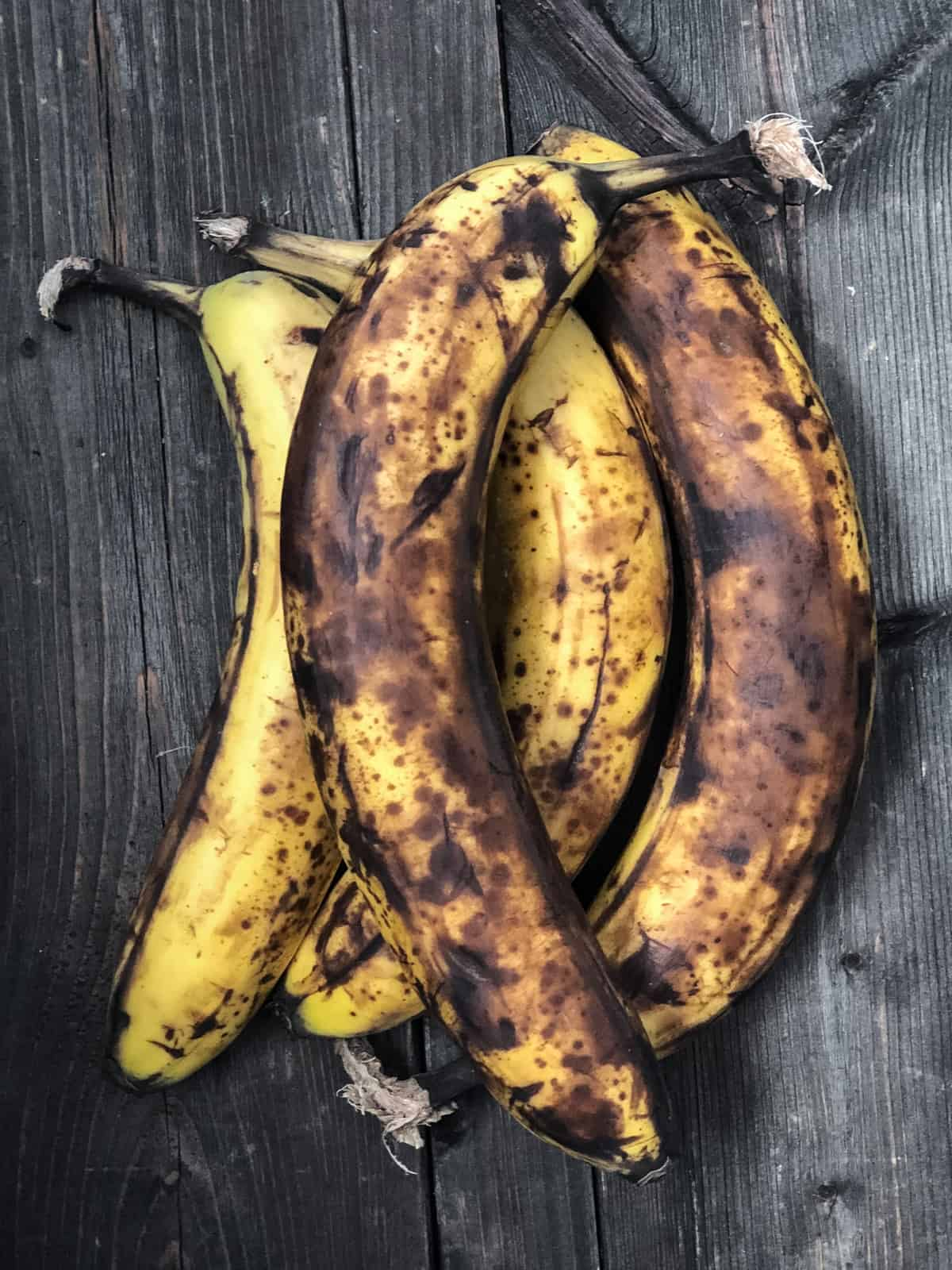 Bunch of spotty bananas for banana nut muffins.