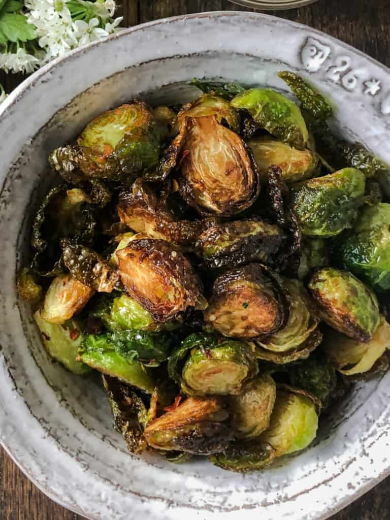 Bowlful of crispy fried Brussel sprouts.