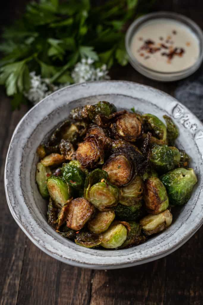 Bowlful of crispy fried Brussels sprouts.