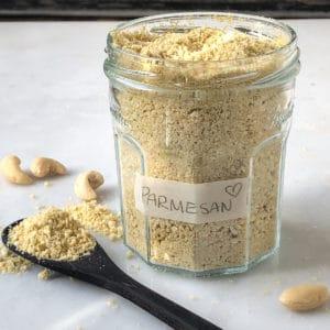 Jar of vegan cashew parmesan cheese.