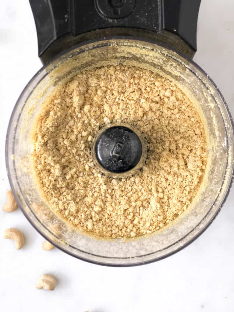 Cashew parmesan cheese ground in food processor.